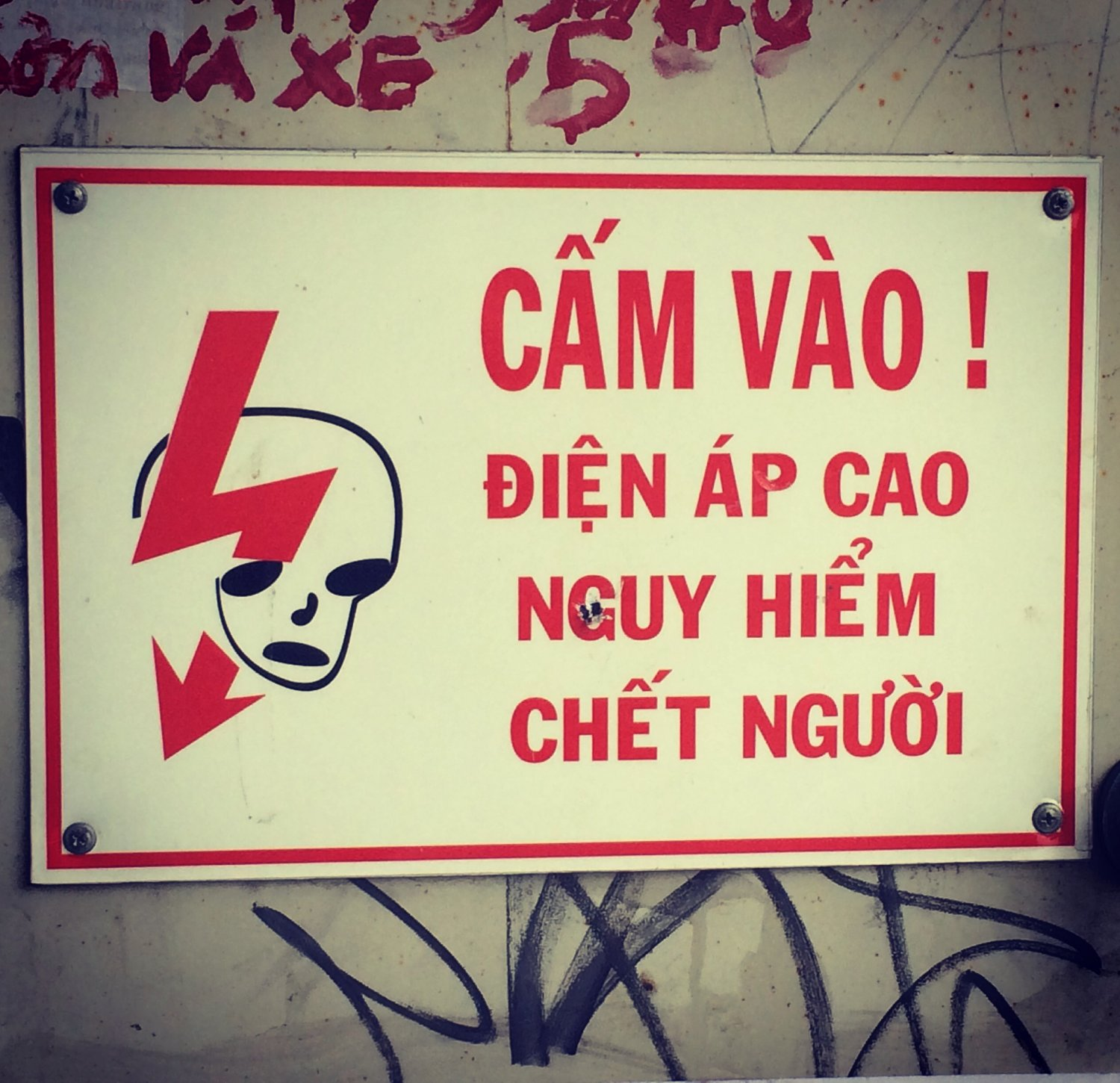 Seen in Nha Trang, Vietnam, electricity warning sign with a touch of Bowie's Aladdin Sane!